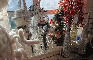 Snow men in window